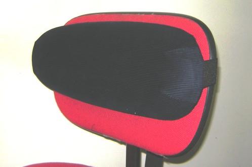 Coussin lombaire installé sur une chaise
